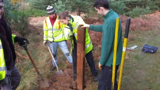 FE & FoTF volunteers install one of the replacement waymarker posts
